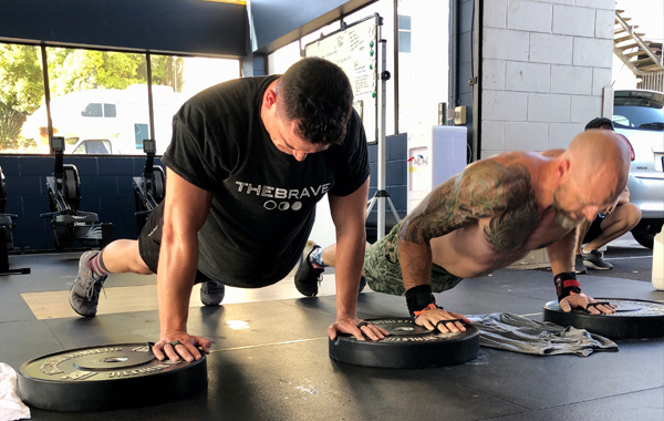 Two men H1 CrossFit PushUps