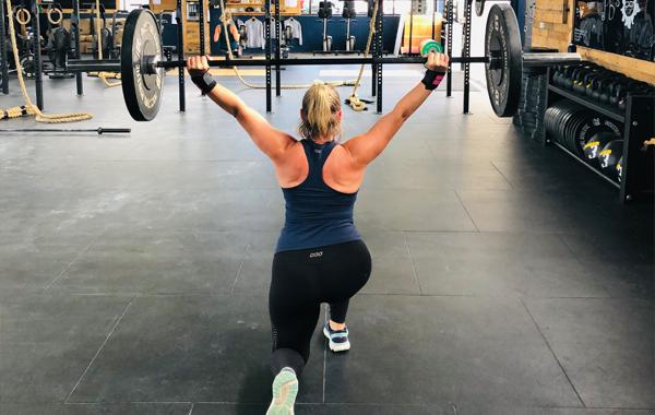 Female CrossFit Overhead Lunge