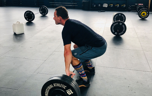 Male CrossFit Clean deadlift set up